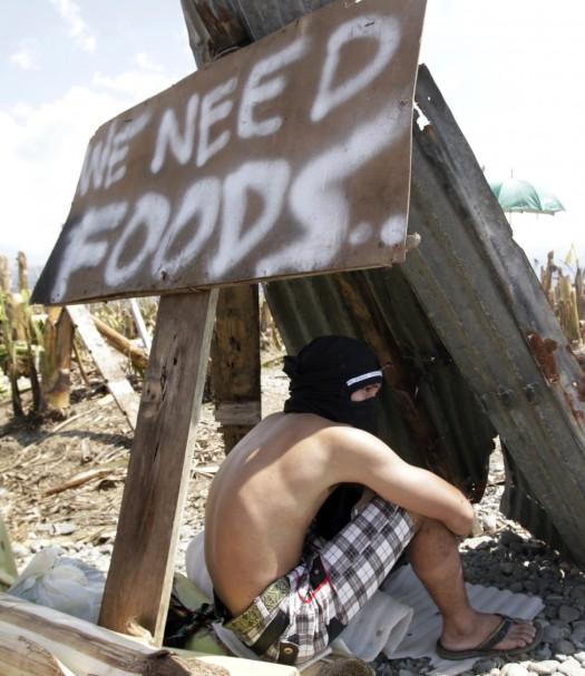 RTR3BDHR_EDITED_Reuters_Philippines_Typhoon_09DEC12-975x1128