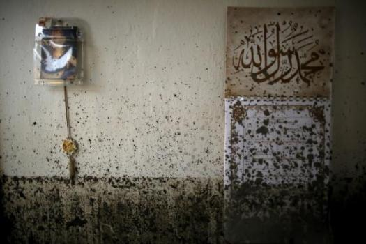 Mud is splattered across a wall in the flood-damaged home of the Kovacevic family in Topcic Polje