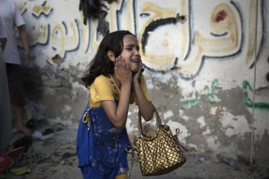 A Palestinian girl reacts at the scene of an explosion that medics said killed eight children and two adults, and wounded 40 others at a public garden in Gaza City
