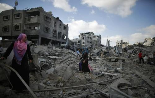 Palestinians inspect the rubble of destroyed houses in the Shejaia neighbourhood, which witnesses said was heavily hit by Israeli shelling and air strikes during an Israeli offensive, in Gaza City