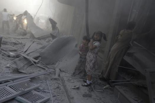 Children react beside a dead body under rubble at a site hit by what activists said were two airstrikes by forces loyal to Syria's President Bashar al-Assad in Douma in eastern al-Ghouta